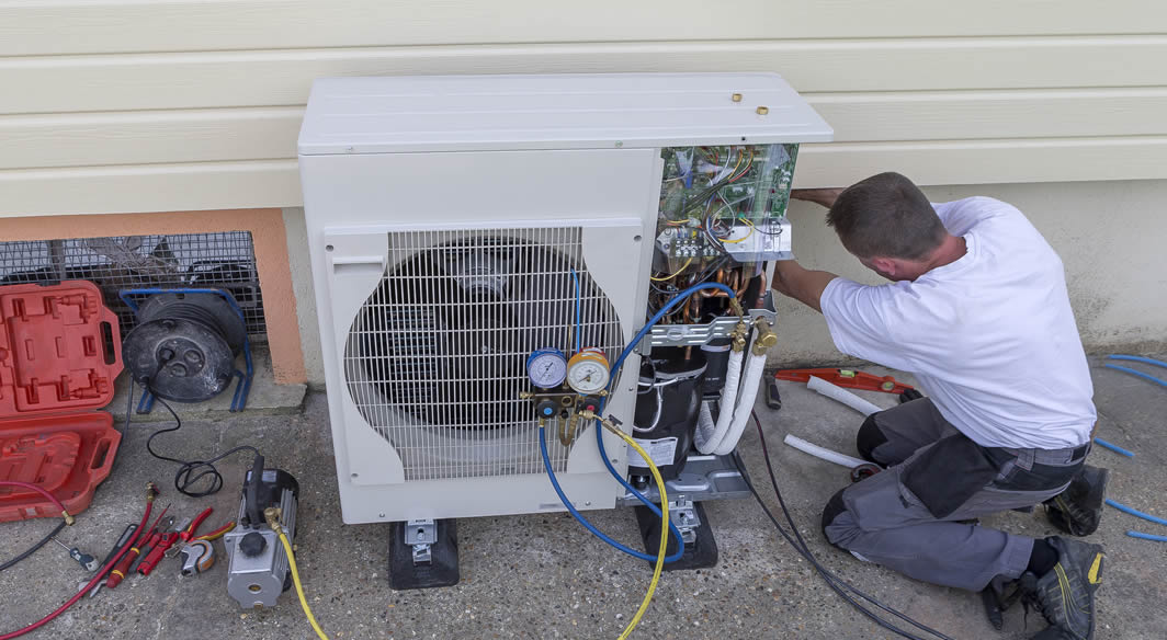 Heating Contractor working on heat pump