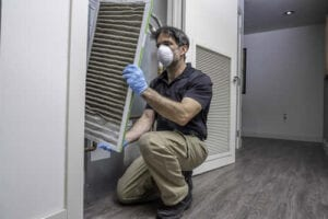 Furnace filter changeout by a furnace repairman
